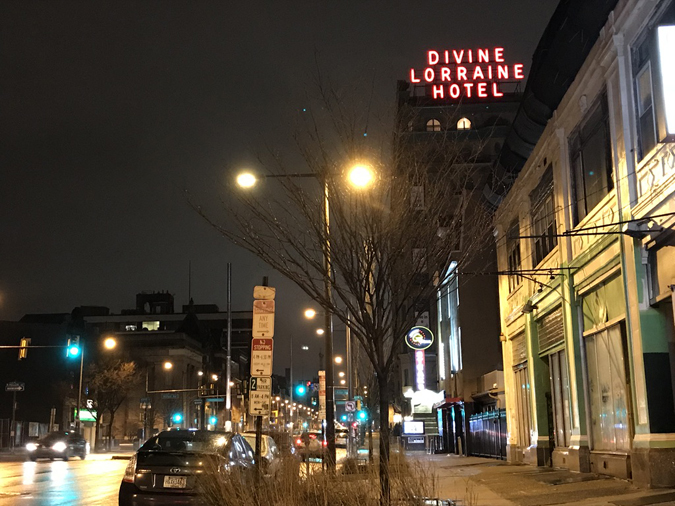 Divine Lorraine's glowing red sign